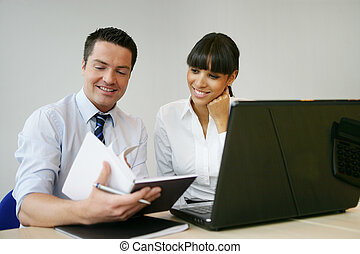 Office workers in front of laptop