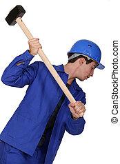 Man holding sledgehammer