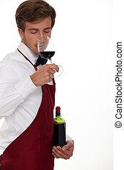 sommelier tasting the wine
