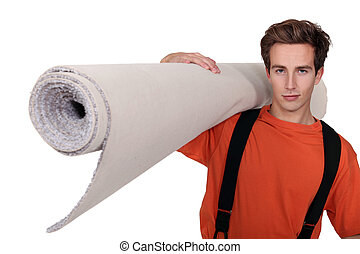 Man carrying a roll of carpet