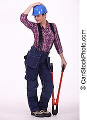 A female construction worker striking a pose