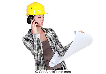 Tradeswoman reporting a problem with a blueprint