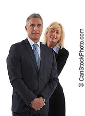 Blonde woman behind  man in a suit