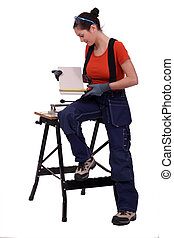 Worker measuring a tile