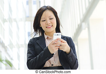 Young executive Texting - Happy oriental Asian young...