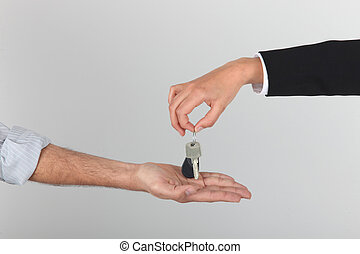 Agent handing over keys to a new home