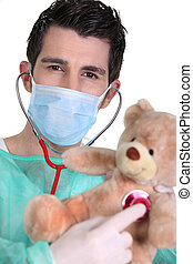 Doctor examining a teddy bear