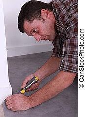 Man topping carpet