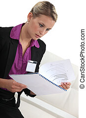 Shocked woman reading document