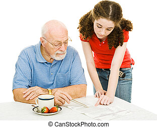Helping Grandpa - Teen girl helping her grandfather read the...