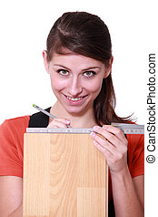 Young woman measuring plank