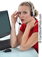 Blond receptionist suffering from headache