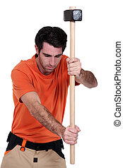 A ma with a sledgehammer.