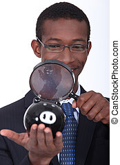 black man with a magnifying glass