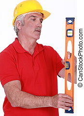 Laborer with spirit level