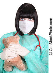nurse wearing surgical mask in paediatric unit