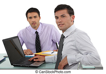 Two male office workers