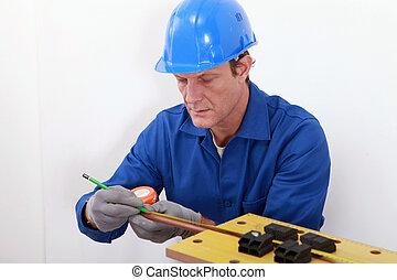 Man measuring tube