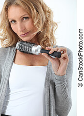 Hair-dresser holding hair-brush