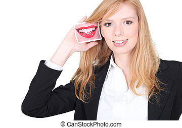 cute blonde holding picture of smiling mouth