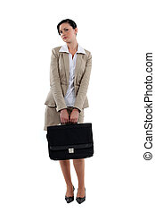 Coy businesswoman stood with briefcase