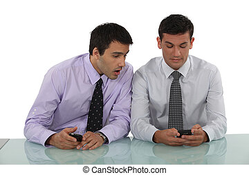 Two men with cellphones