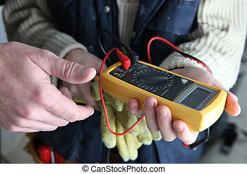 Apprentice using multimeter