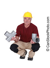 Plumber with plastic pipes