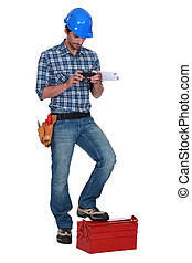 Laborer using mobile phone