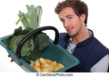 portrait of a gardener with vegetables