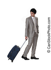 A businessman leaving on a business trip