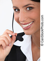 Close up of a smiling telephonist