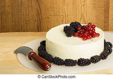 Round of fresh cheese with berries