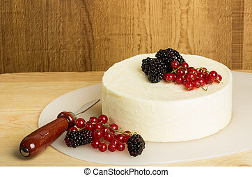 Round of cheese with currants and berries