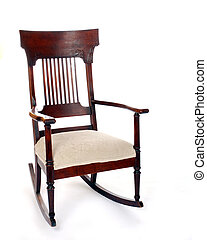 Empty Rocking Chair - An empty antique rocking chair,...