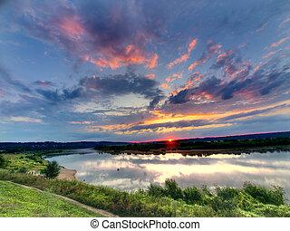 Wonderful sunrise over river - Beautiful summer sunrise over...