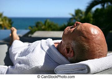 Senior man having sunbath