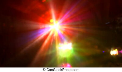 Powerful laser lighting the discotheque with colourful rays