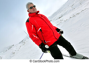 Senior man skiing