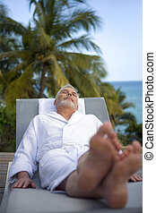 Man relaxing on a tropical island