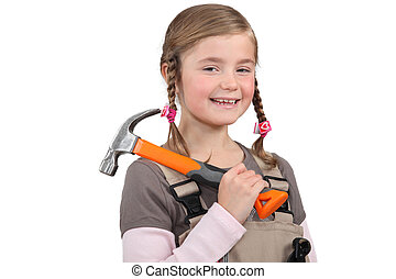 Young girl with a hammer