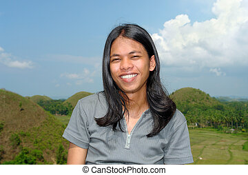 Portrait of longhaired Asian boy - Portrait of smiling...