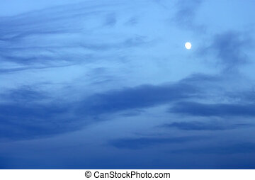 Moon in the clouds - Full moon in the bluish evening clouds
