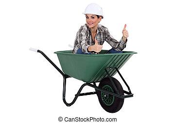 Female worker in a wheelbarrow