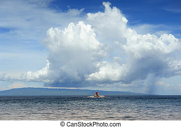 Tropical cloudscape with boat - Majestic tropical cloudscape...