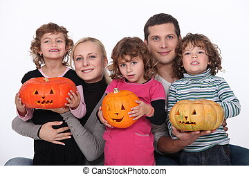 Family with carved pumpkins