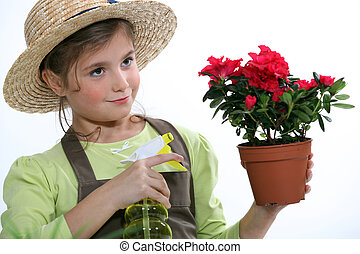 Girl caring plant