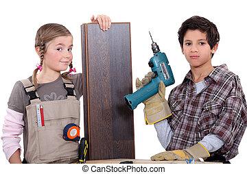 children dressed as carpenters