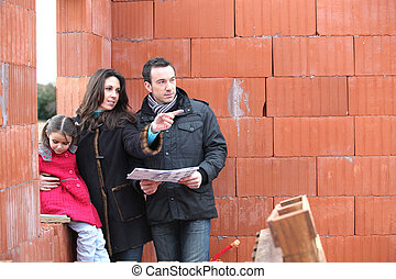 Couple visiting unfinished house