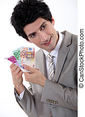 Businessman holding Euro bank notes